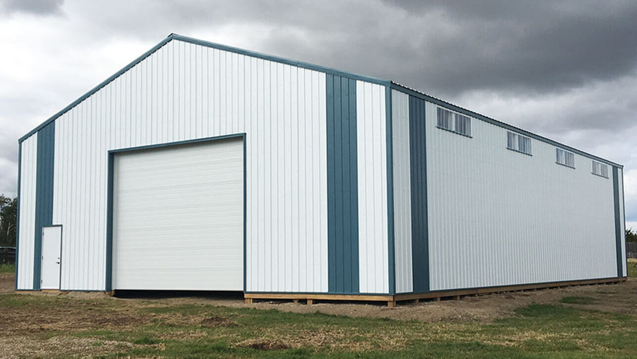custom-building-machinery-storage-white-green-st-paul-alberta