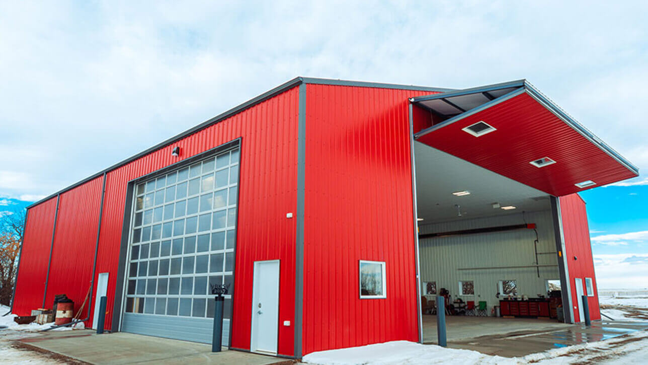 custom-building-shop-overhead-door-bi-fold-door-red-beiseker