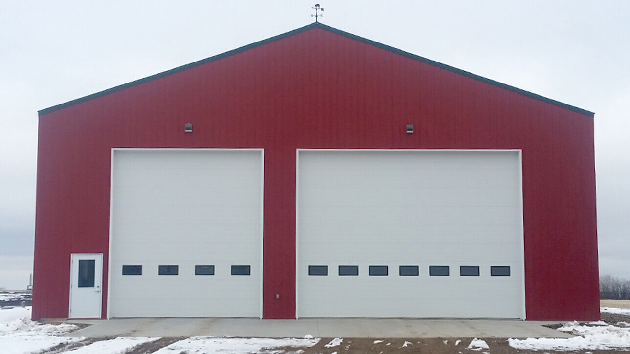 custom-building-shop-red-white-wainwright-overhead-doors